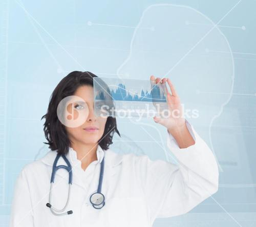 Brunette serious doctor looking at a new technology