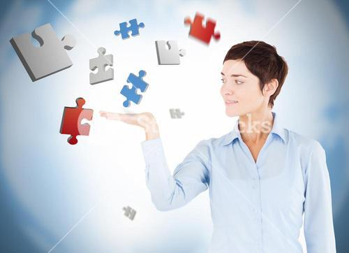 Well dressed woman with puzzles levitating