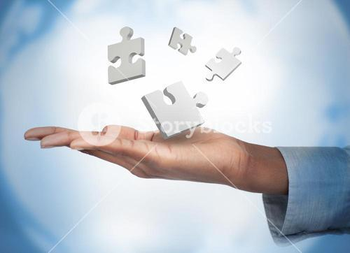Hand with digital white puzzles