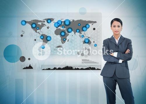 Serious businesswoman standing with a digital world map