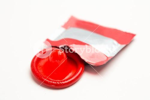 Red condom with wrapper