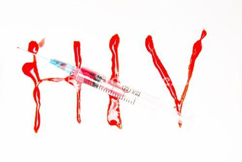 HIV spelled out in blood and syringe filled with blood