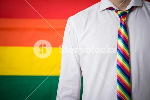 Man wearing shirt and rainbow tie