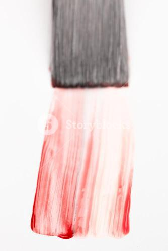 Paintbrush with red brush stroke