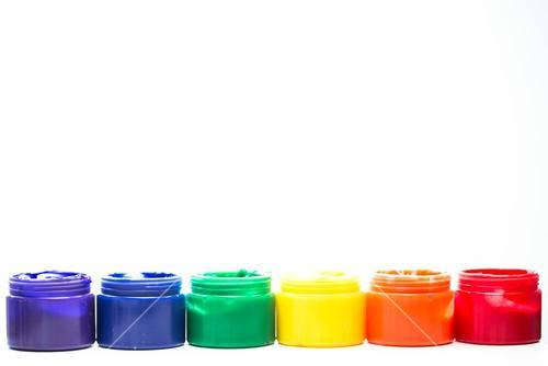Rainbow paint pots in a row for gay pride