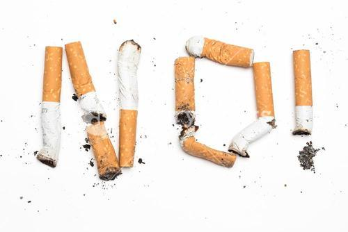 No with exclamation mark spelled out in cigarette butts