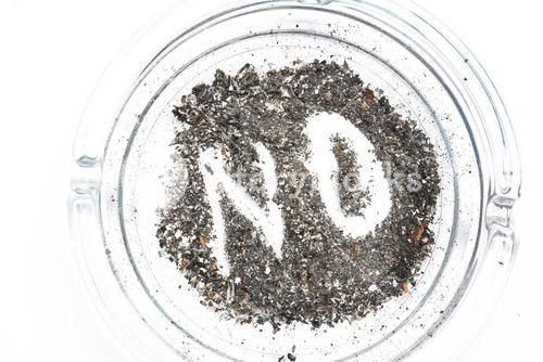 No spelled out in the ash in ashtray
