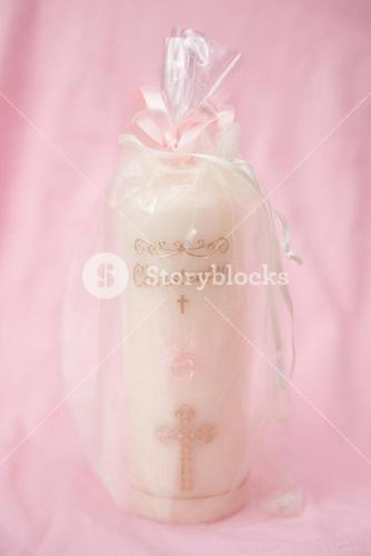 Christening candle wrapped up for a girl