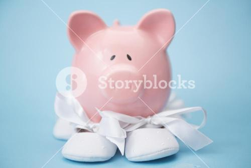 Piggy bank wearing white baby booties