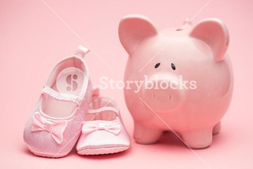 Pink booties and piggy bank