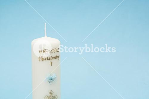 Christening candle with blue detail and copy space
