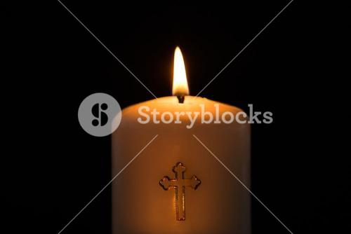Candle with cross embellishment
