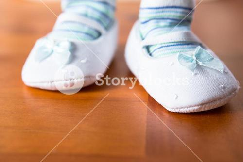 Baby in booties taking first step