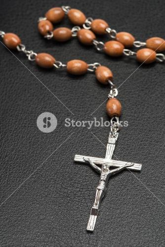 Rosary beads resting on a bible