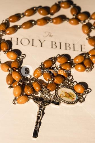 Rosary beads on page of bible