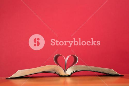 Book with pages folded to form heart