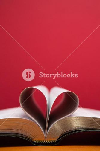 Embossed pages of book folded to make heart