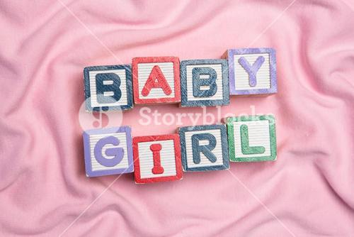 Baby girl spelled out in blocks