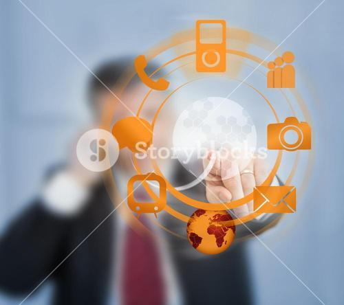 Businessman using orange wheel interface for computer applications