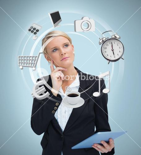 Businesswoman considering various applications of tablet pc