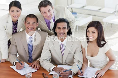 Happy business people working at computers