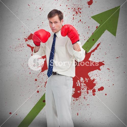 Businessman in boxing gloves against profit arrow and blood spatter
