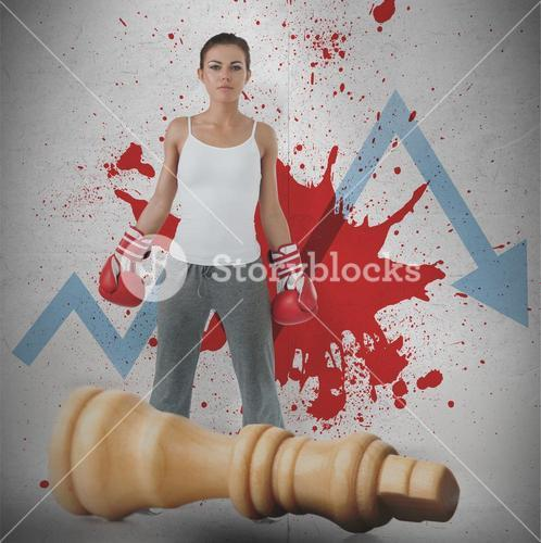 Female boxer against loss arrow and blood spatter with fallen chess piece