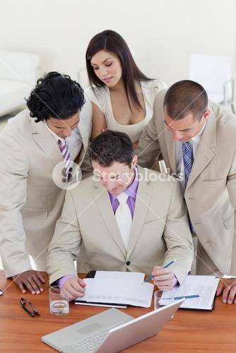 International business people studying a document