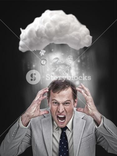 Businessman stressing out under a cloud