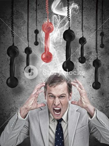 Stressed out businessman with phone receivers