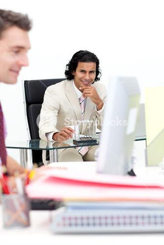 Two smiling businessmen working in the office