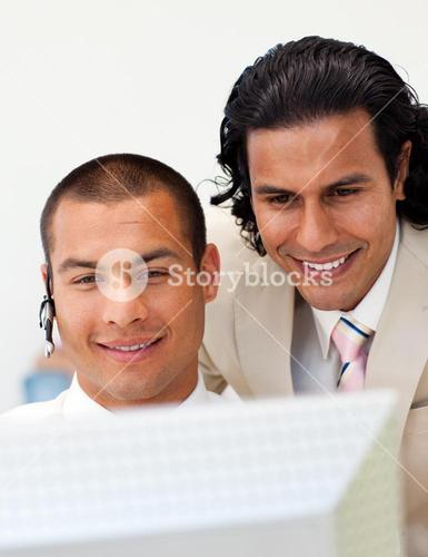 Two colleagues looking at a computer