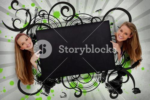 Girls pointing to black copy space with artistic black swirls