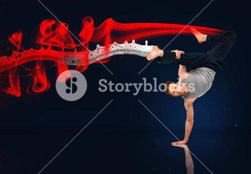 Martial arts expert doing hand stand