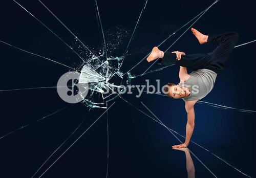 Martial arts expert against broken glass background