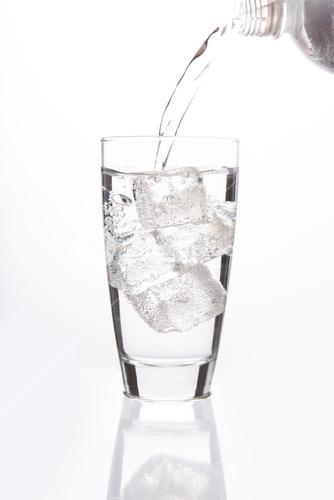 Sparkling water filling glass