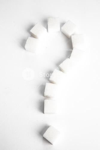 Sugar cubes in shape of question mark