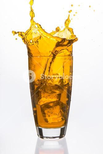Ices cubes falling in a glass