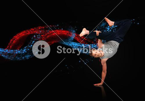 Break dancer showing his agility and balance