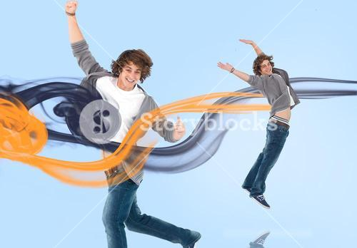 Two of the same young man jumping for joy