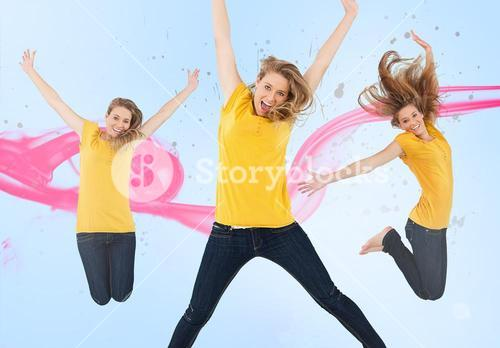 Three of the same young woman jumping for joy