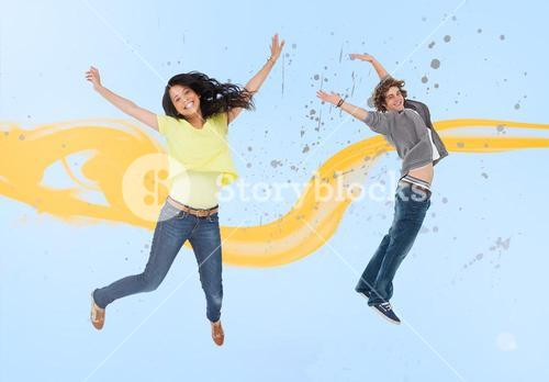 Attractive young man and woman jumping for joy