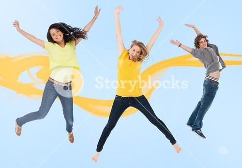 Attractive young man and women jumping for joy