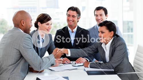 Happy business people closing a deal