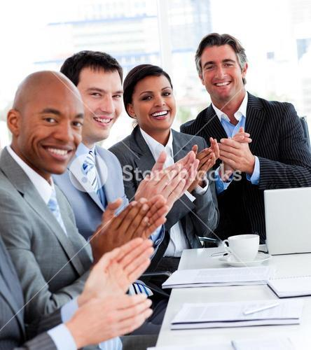 Team of successful business people applauding