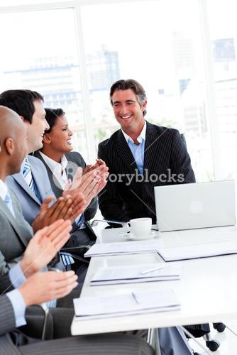 Team of successful business team applauding in a conference
