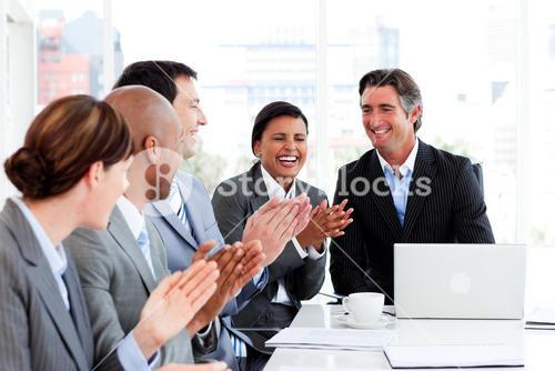 Smiling business team applauding