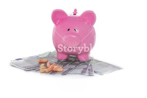 Piggy bank on pile of dollars with tablets