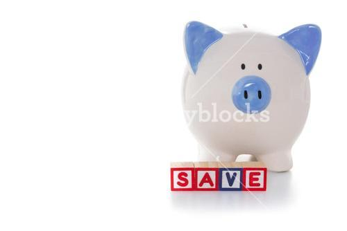 Blocks spelling save in front of piggy bank