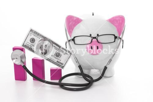 Pink and white piggy bank wearing glasses and stethoscope